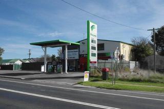 Service Station adjacent to property