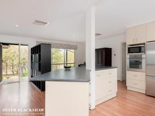 Well equipped kitchen over looking family room